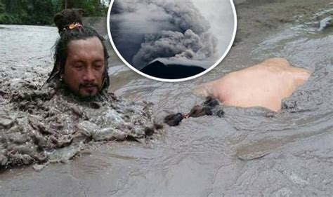 Bali volcano: Man BATHES in Mt Agung cold lava flow in