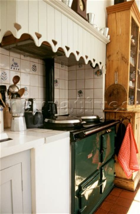 PE009_19: Green aga cooker in country style kitchen