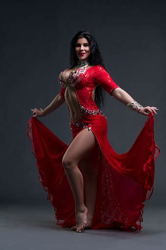 Young Beautiful Exotic Women Performs Belly Dance In Red